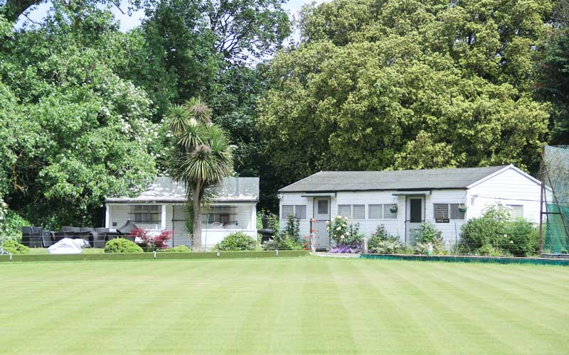 Photo image of the men's and women's huts at Southwark Sports Lawn Bowls Club